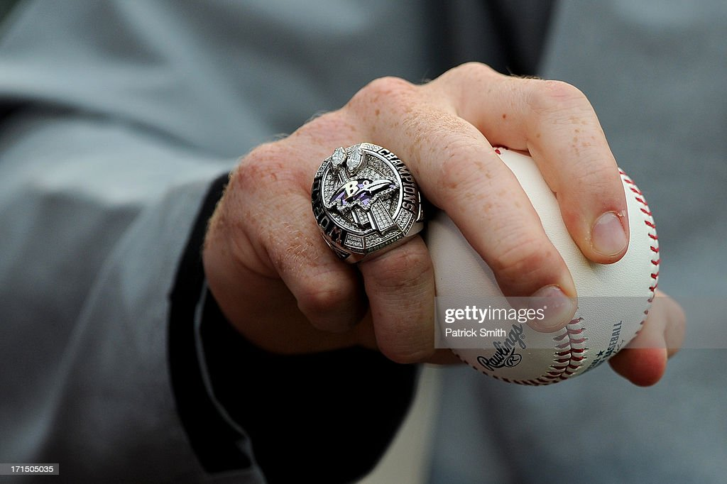 Baltimore Ravens player Morgan Cox holds a Rawlings baseball as he wears his Baltimore Ravens' Super Super Bowl XLVII championship ring before the...