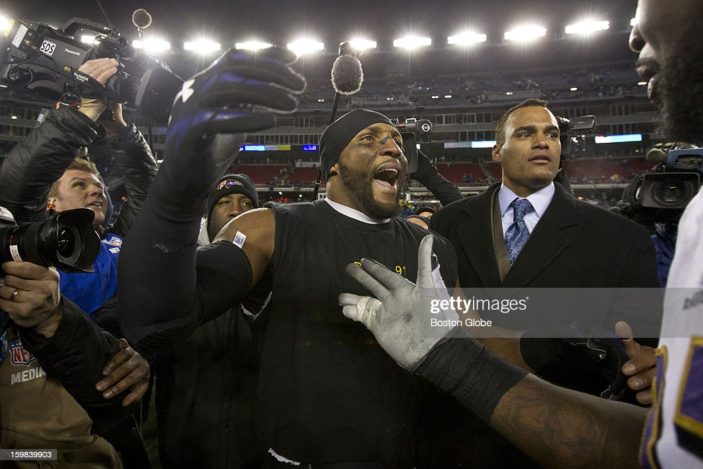 Baltimore Ravens player Ray Lewis gets ready to hug a teammate after they defeated the New England Patriots 28-13 during the AFC Championship Game at Gillette Stadium on Sunday, Jan. 20, 2013.