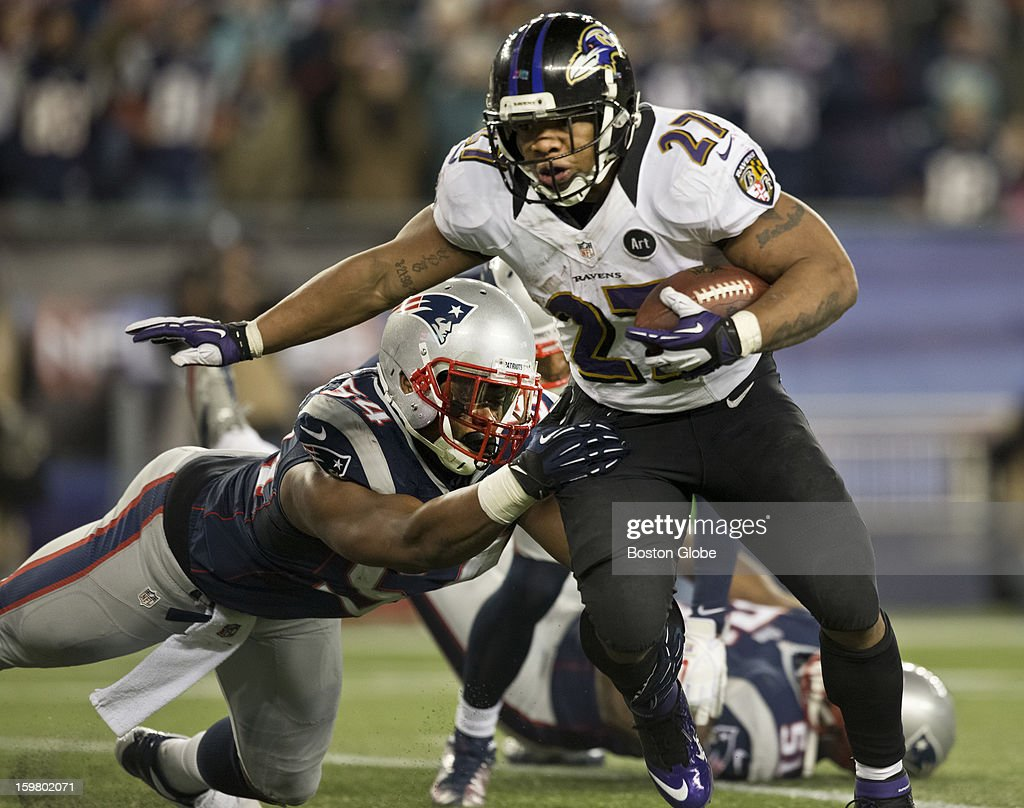 Baltimore Ravens player Ray Rice breaks the tackle of New England Patriots player Dont'a Hightower en route to a rushing touchdown during second quarter action of the AFC Championship Game at Gillette Stadium on Sunday, Jan. 20, 2013.