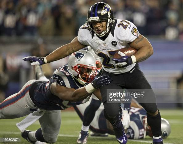 Baltimore Ravens player Ray Rice breaks the tackle of New England Patriots player Dont'a Hightower en route to a rushing touchdown during second...