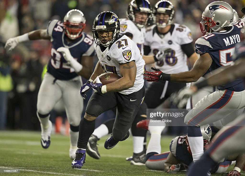 Baltimore Ravens player Ray Rice runs past New England Patriots player Jerod Mayo during second quarter action of the AFC Championship Game at Gillette Stadium on Sunday, Jan. 20, 2013.