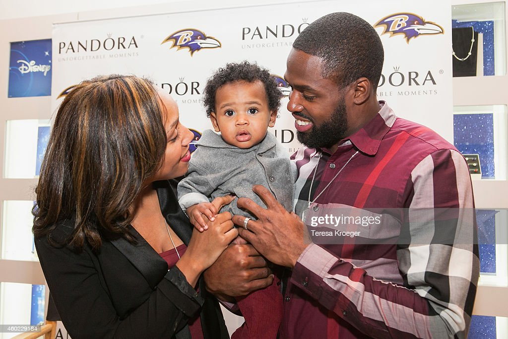 Baltimore Ravens player Torrey Smith Chanel Smith and their son TJ Smith attend a PANDORA Jewelry InStore event at Columbia Mall on December 9 2014...