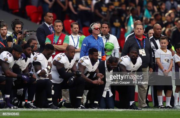 Baltimore Ravens players kneel in protest during the national anthem before the NFL International Series match at Wembley Stadium London