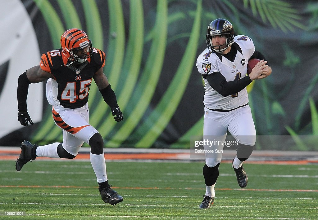 Baltimore Ravens punter Sam Koch beats Cincinnati Bengals defender Jeromy Miles for a 4th-quarter first down on a fake punt at Paul Brown Stadium on Sunday, December 30, 2012, in Cincinnati, Ohio. The Cincinnati Bengals defeated the Baltimore Ravens, 23-17.