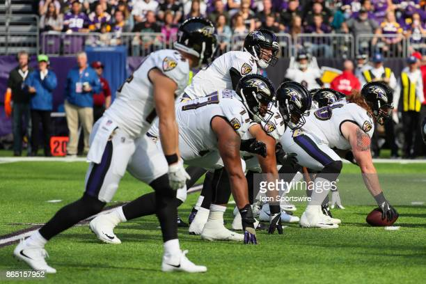 Baltimore Ravens quarterback Joe Flacco calls the play at the line of scrimmage during a game between the Minnesota Vikings and Baltimore Ravens on...