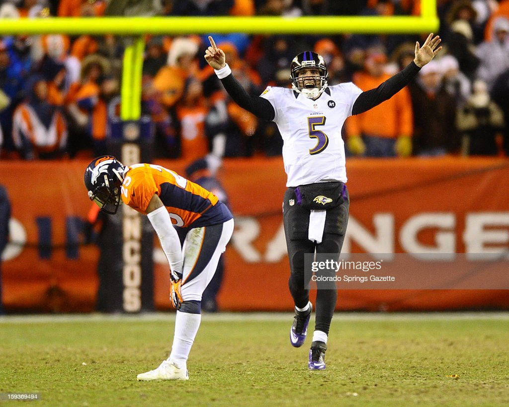 Baltimore Ravens quarterback Joe Flacco (5) celebrates his 70-yard touchdown pass to Jacoby Jones late in the fourth quarter as the Denver Broncos' Chris Harris is bent over with grief in the AFC Divisonal Playoff at Sports Authority Field at Mile High in Denver, Colorado, on Saturday, January 12, 2013. Baltimore won in OT, 38-35.