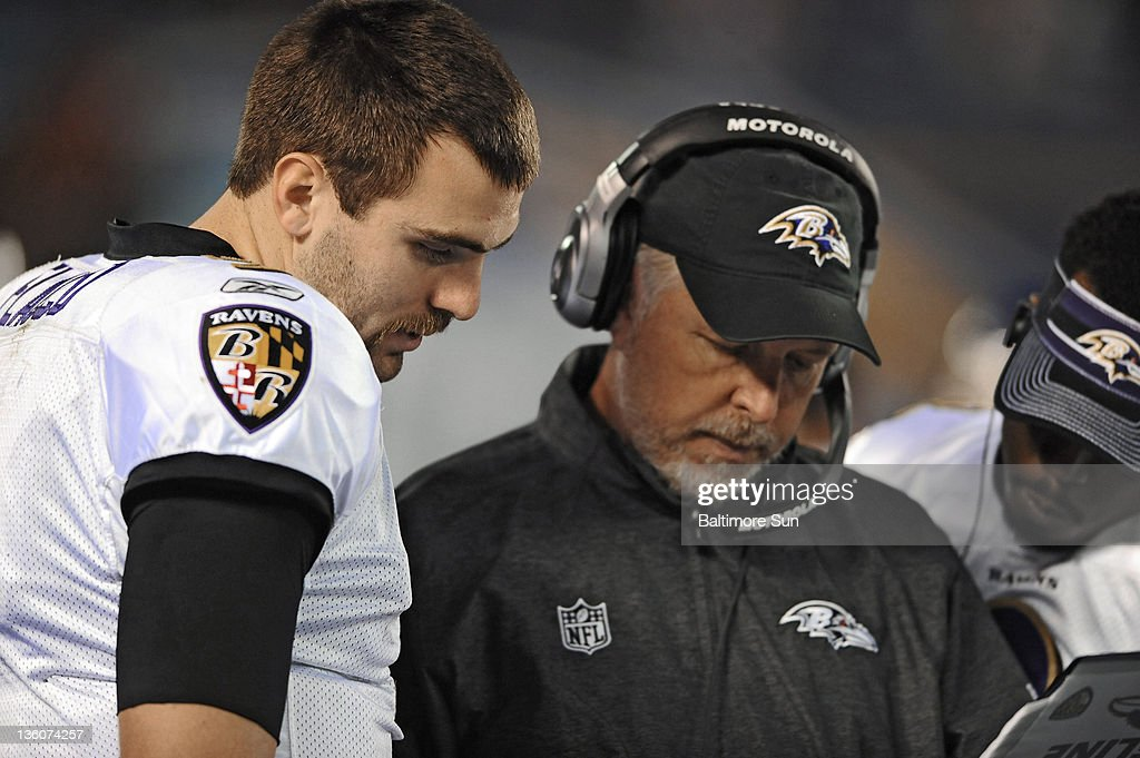 Baltimore Ravens quarterback Joe Flacco, from left, hurdles with offensive coordinator Cam Cameron and back-up quarterback Tyrod Taylor at the sideline after Flacco's second interception in the third quarter against the San Diego Chargers in San Diego, California, Sunday, December 18, 2011.