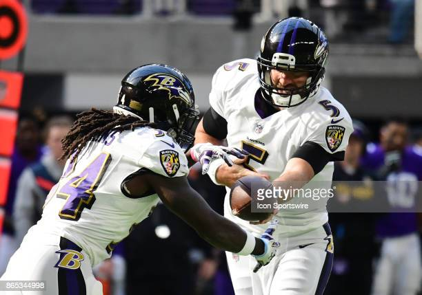 Baltimore Ravens quarterback Joe Flacco hands the ball off to Baltimore Ravens running back Alex Collins during a NFL game between the Minnesota...