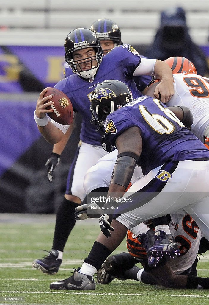 Baltimore Ravens quarterback Joe Flacco is brought down by Cincinnati Bengals' Carlos Dunlap (96) and Geno Atkins (97) during 2nd-quarter action. The Ravens defeated the Bengals, 13-7, on Sunday, January 2, 2011, at M&T Bank Stadium in Baltimore, Maryland.