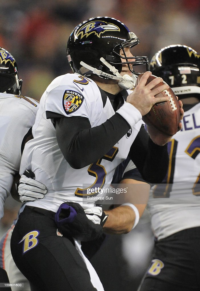 Baltimore Ravens quarterback Joe Flacco is brought down by New England Patriots Rob Ninkovich (50) for a 2nd quarter sack in the AFC Championship game at Gillette Stadium in Foxboro, Massachusetts, Sunday, January 20, 2013.