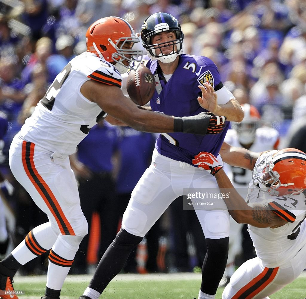 Baltimore Ravens quarterback Joe Flacco (5) is sacked by Cleveland Browns Desmond Bryant (92) and Jabaal Sheard (97) in the second quarter at M&T Bank Stadium in Baltimore, Maryland, Sunday, September 15, 2013.