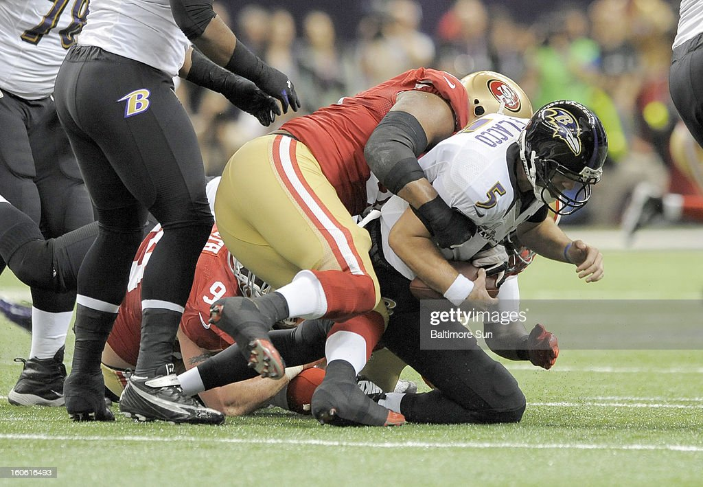 Baltimore Ravens quarterback Joe Flacco (5) is sacked by San Francisco 49ers Ray McDonald (91) during 1st-quarter action in Super Bowl XLVII at the Mercedes-Benz Superdome in New Orleans, Louisiana, Sunday, February 3, 2013.