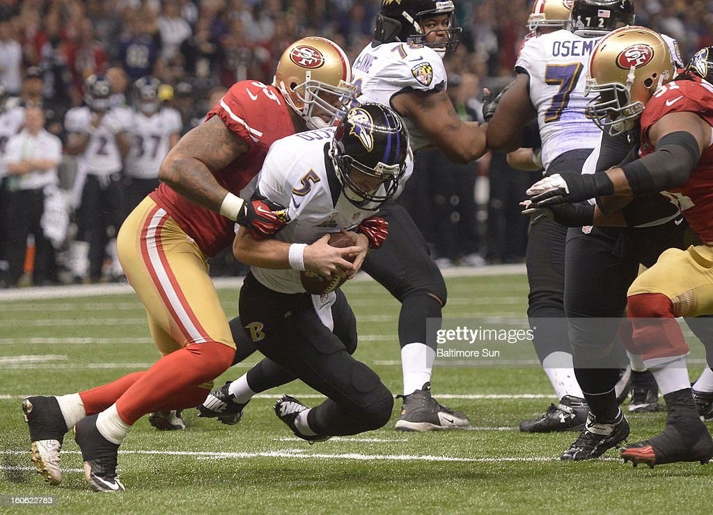 Baltimore Ravens quarterback Joe Flacco (5) is sacked in the third quarter against the San Francisco 49ers during Super Bowl XLVII at the Mercedes-Benz Superdome in New Orleans, Louisiana, Sunday, February 3, 2013.