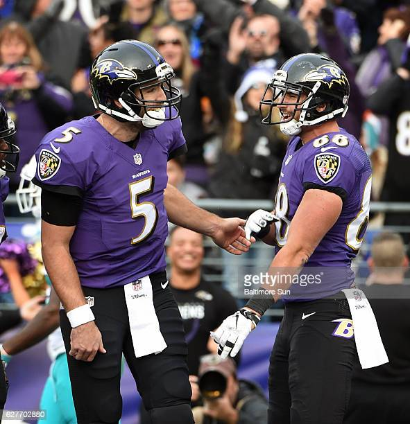 Baltimore Ravens quarterback Joe Flacco left celebrates with tight end Dennis Pitta after the two connected for their second touchdown of the game a...