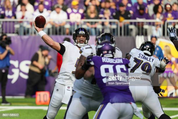 Baltimore Ravens quarterback Joe Flacco passes the ball during a game between the Minnesota Vikings and Baltimore Ravens on October 22 at US Bank...