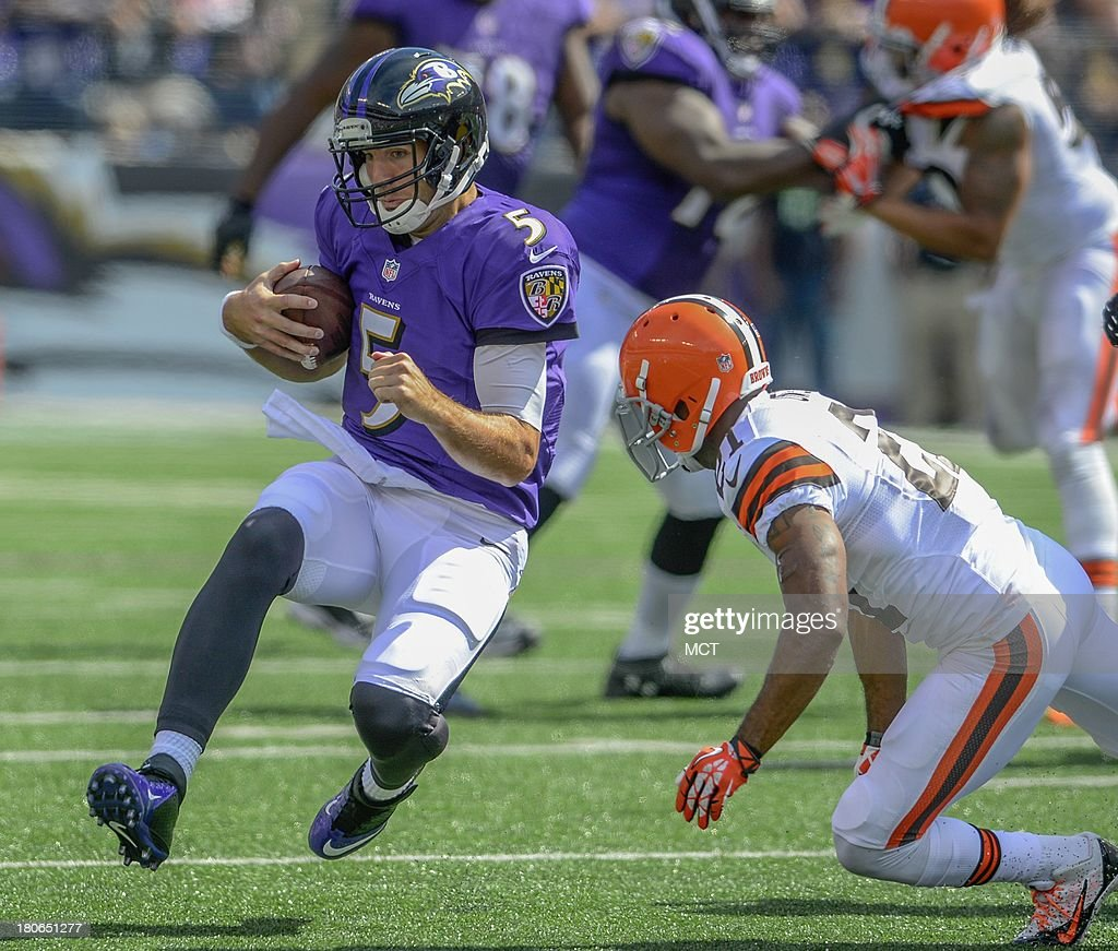 Baltimore Ravens quarterback Joe Flacco prepares for a hit by Cleveland Browns cornerback Chris Owens after scrambling during the first half of their game on Sunday, September 15, 2013, in Baltimore, Maryland.