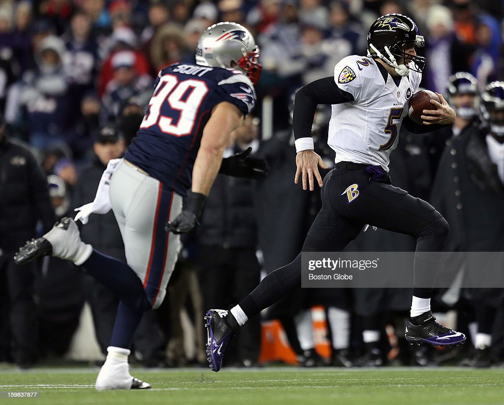 Baltimore Ravens quarterback Joe Flacco (#5) takes the ball as he scrambles down the sidelines for a 14-yard first down run as the New England Patriots hosted the Baltimore Ravens in the AFC Championship Game at Gillette Stadium.