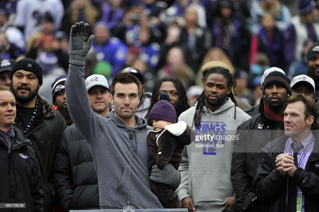 Baltimore Ravens quarterback Joe Flacco, who was named MVP of Super Bowl XLVII, waves to fans after a short speech during the Ravens Super Bowl celebration at M&T Bank Stadium in Baltimore, Maryland, Tuesday, February 5, 2013.