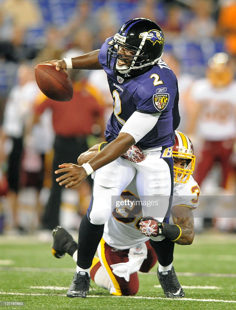 Baltimore Ravens quarterback <a gi-track='captionPersonalityLinkClicked' href=/galleries/search?phrase=Tyrod+Taylor&family=editorial&specificpeople=4489709 ng-click='$event.stopPropagation()'>Tyrod Taylor</a> attempts to escape the grasp of a Redskins defender in the second half. The Baltimore Ravens defeat the Washington Redskins 34-31 in their preseason game on Thursday, August 25, 2011, in Baltimore, Maryland.