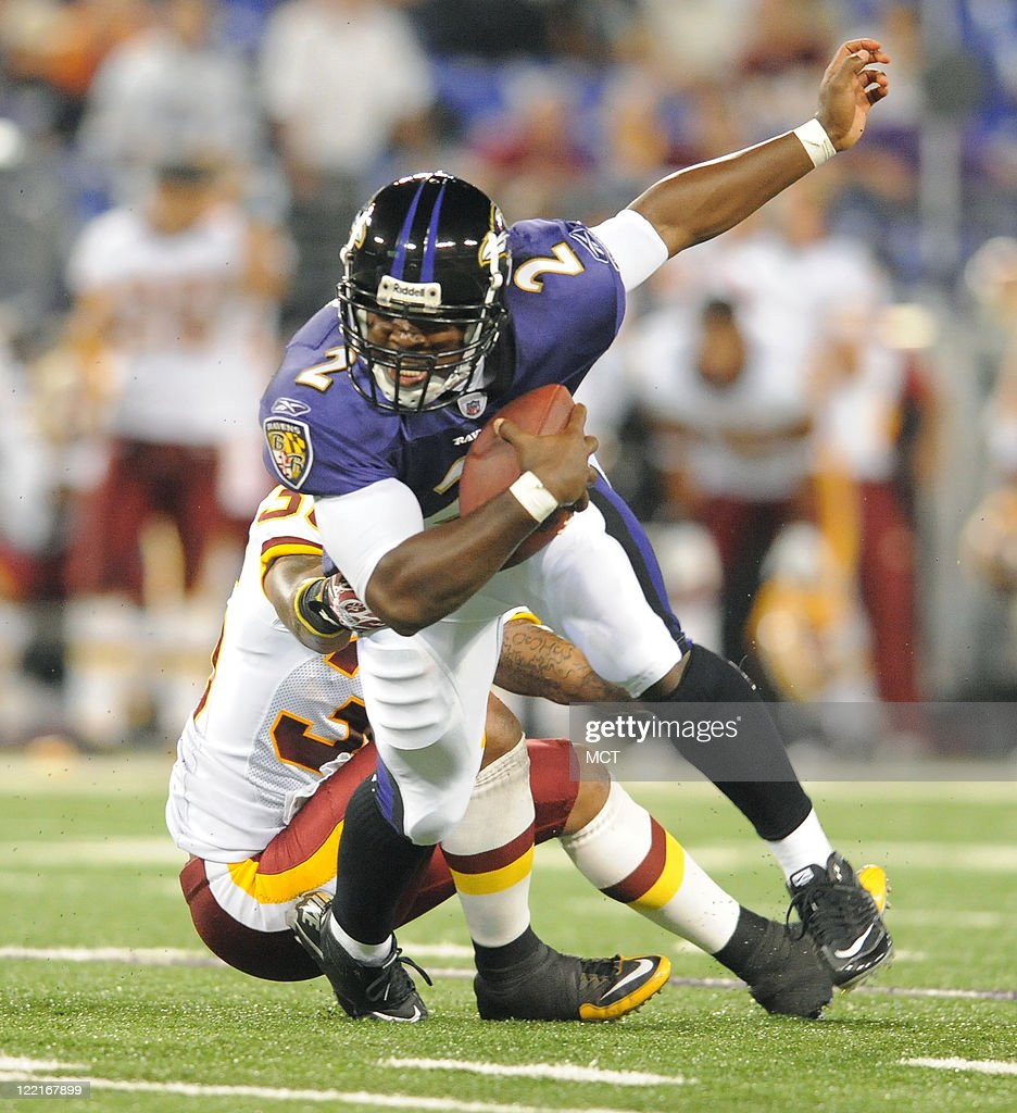 Baltimore Ravens quarterback Tyrod Taylor attempts to escape the grasp of a Redskins defender in the second half. The Baltimore Ravens defeat the Washington Redskins 34-31 in their preseason game on Thursday, August 25, 2011, in Baltimore, Maryland.