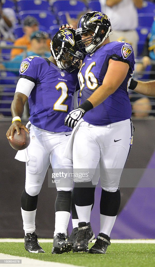Baltimore Ravens quarterback Tyrod Taylor is congratulated by teammate Gino Gradkowski after scoring a touchdown against Jacksonville in the second half of their preseason game in Baltimore, Maryland, on Thursday, August 23, 2012.