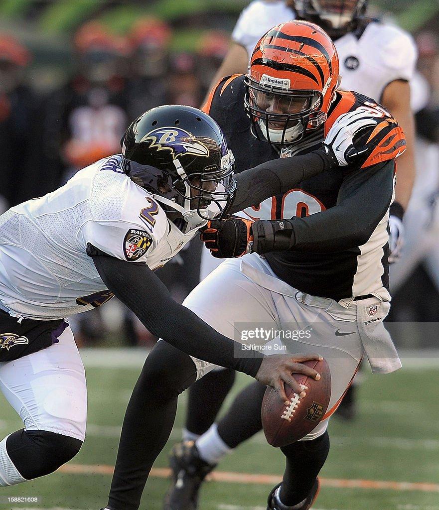 Baltimore Ravens quarterback Tyrod Taylor is sacked by Cincinnati Bengals' Carlos Dunlap during 4th-quarter action at Paul Brown Stadium on Sunday, December 30, 2012, in Cincinnati, Ohio. The Cincinnati Bengals defeated the Baltimore Ravens, 23-17.