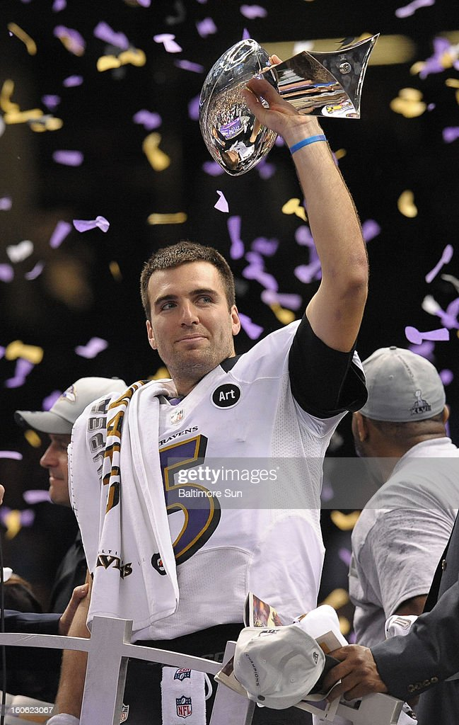 Baltimore Ravens quaterback Joe Flacco holds the Lombardi Trophy after a 34-31 win against the San Francisco 49ers in Super Bowl XLVII at the Mercedes-Benz Superdome in New Orleans, Louisiana, Sunday, February 3, 2013.