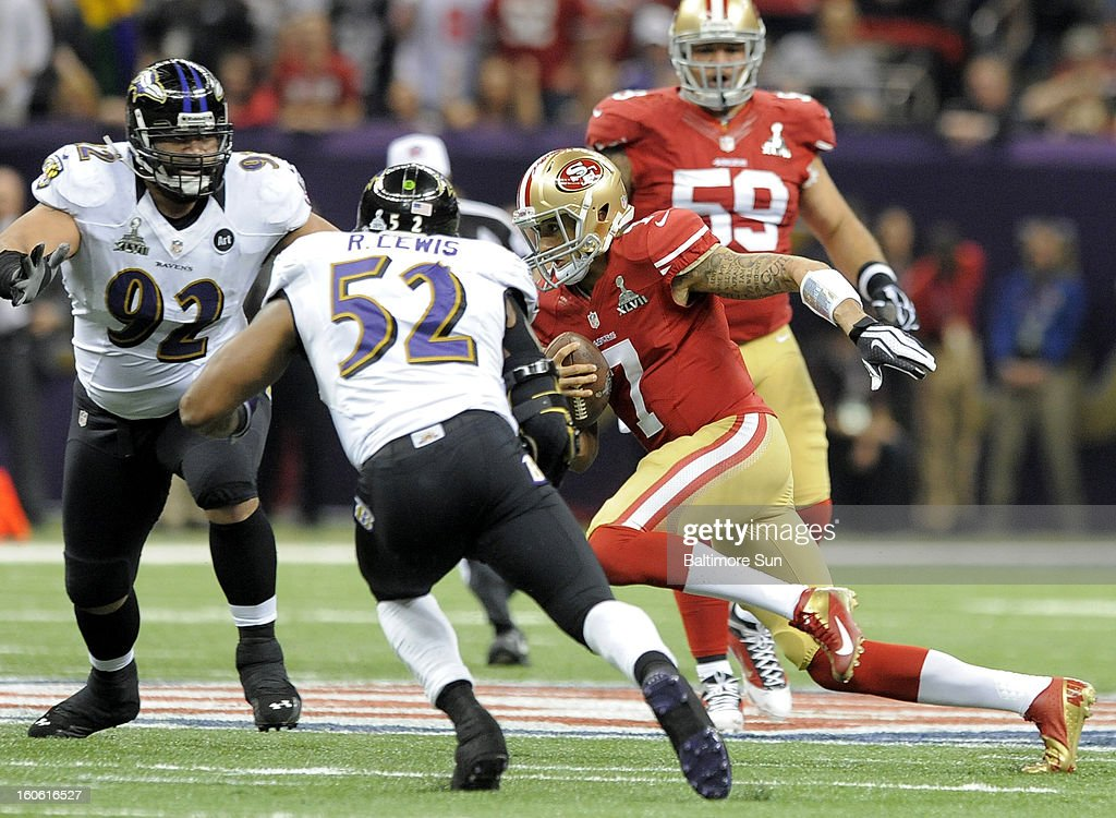 Baltimore Ravens' Ray Lewis and Haloti Ngata try to shut the door on San Francisco 49ers quarterback Colin Kaepernick (7) during first-quarter action in Super Bowl XLVII at the Mercedes-Benz Superdome in New Orleans, Louisiana, Sunday, February 3, 2013.
