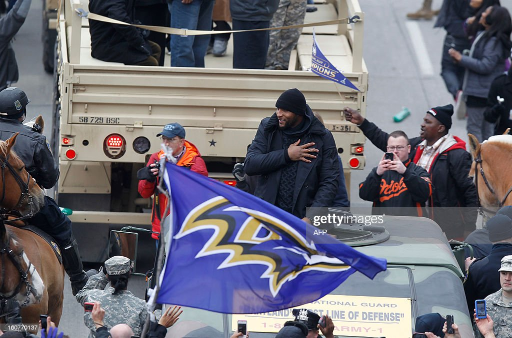 Baltimore Ravens Ray Lewis greets fans as he takes part in the Ravens Victory Parade in Baltimore on February 5, 2013. The Ravens defeated the San Francisco 49's to win the NFL Championship Super Bowl in New Orleans on February 3. AFP PHOTO/Molly RILEY