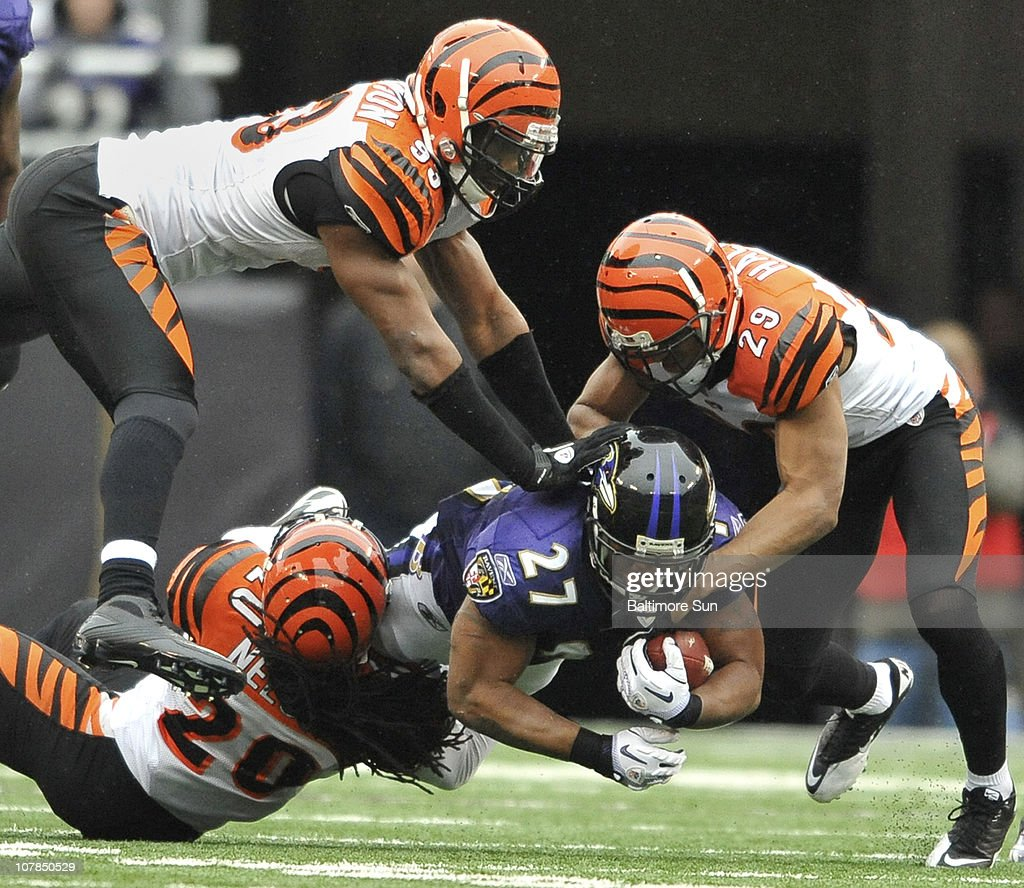 Baltimore Ravens' Ray Rice is tackled by Cincinnati Bengals Reggie Nelson (20), Michael Johnson (93) and Leon Hall (29) in the first half. The Ravens defeated the Bengals, 13-7, on Sunday, January 2, 2011, at M&T Bank Stadium in Baltimore, Maryland.