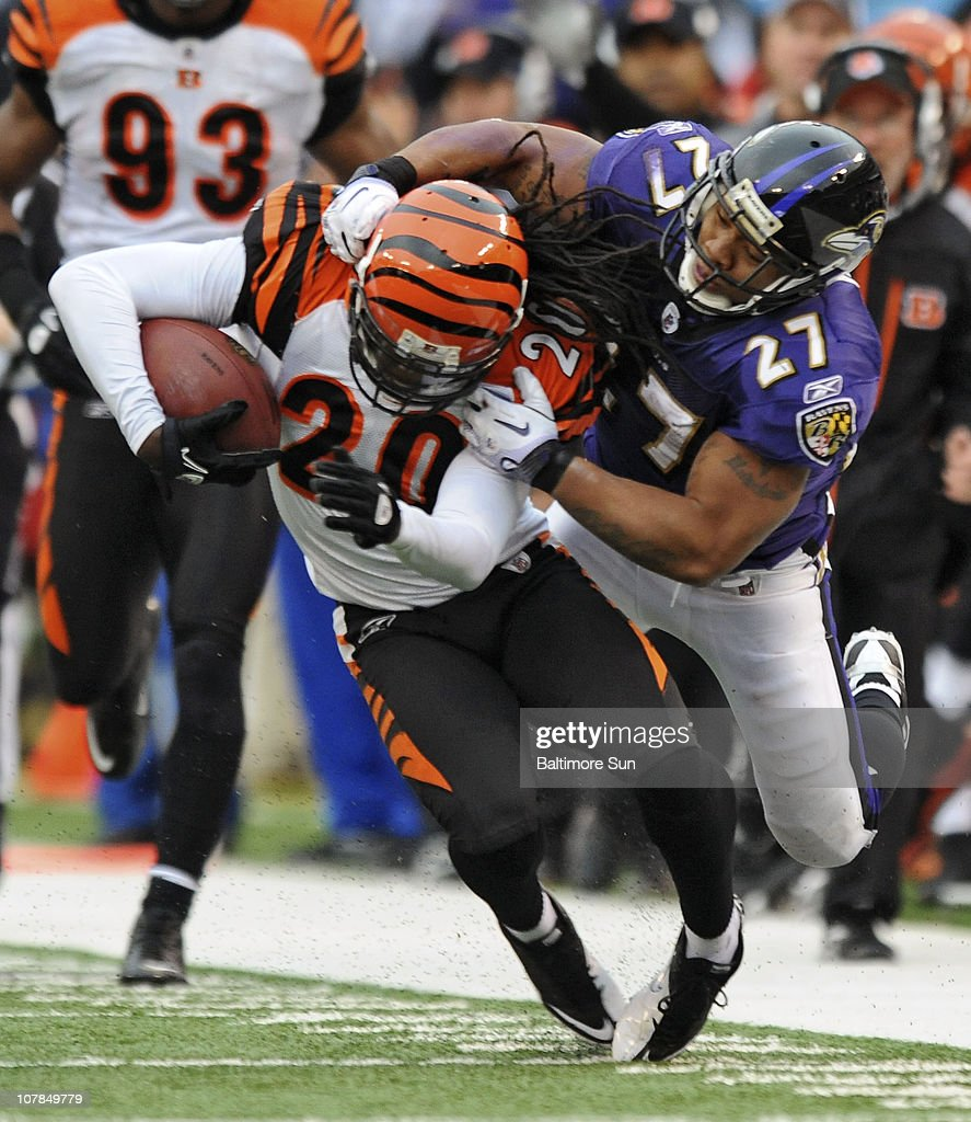 Baltimore Ravens' <a gi-track='captionPersonalityLinkClicked' href=/galleries/search?phrase=Ray+Rice&family=editorial&specificpeople=3980395 ng-click='$event.stopPropagation()'>Ray Rice</a>, right, brings down Cincinnati Bengals' Reggie Nelson (20), who returned an interception 56-yards during the second quarter. The Ravens defeated the Bengals, 13-7, on Sunday, January 2, 2011, at M&T Bank Stadium in Baltimore, Maryland.