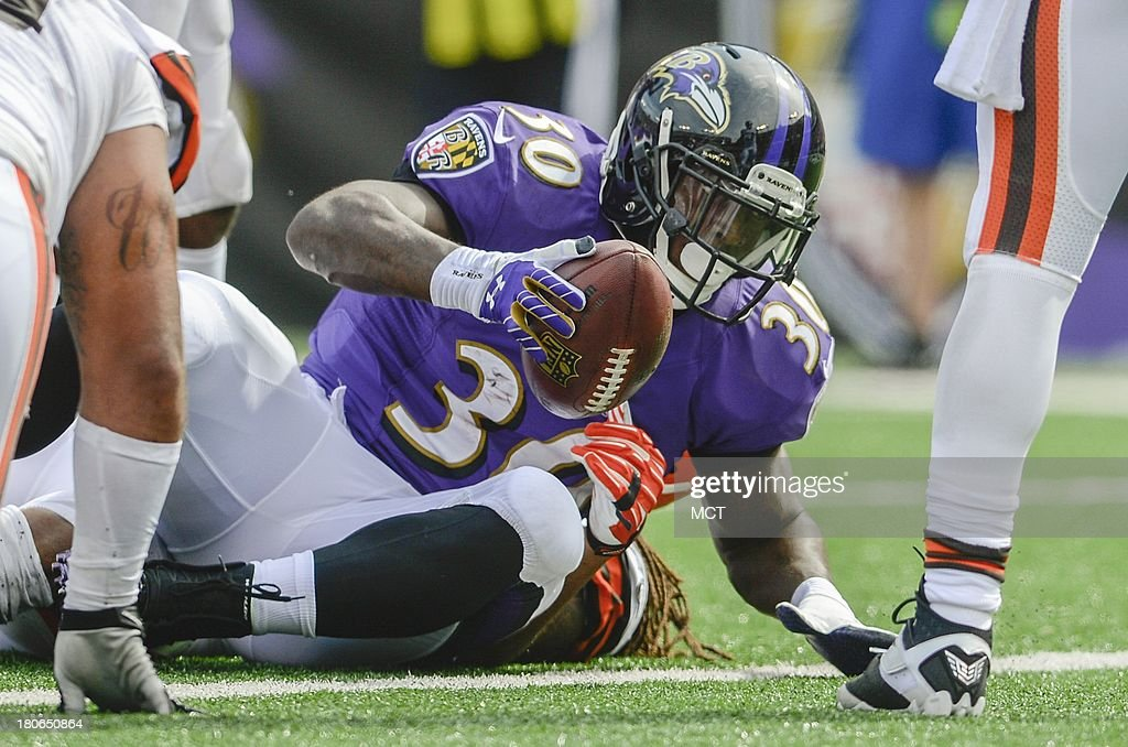Baltimore Ravens running back Bernard Pierce crosses the goal line with Baltimore's first touchdown of the day against the Cleveland Browns during the second half of their game on Sunday, September 15, 2013, in Baltimore, Maryland.