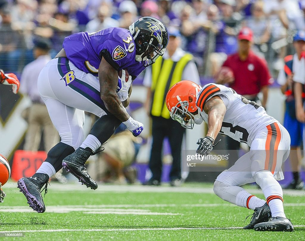 Baltimore Ravens running back Bernard Pierce prepares for impact with Cleveland Browns cornerback Joe Haden during the second half of their game on Sunday, September 15, 2013, in Baltimore, Maryland.