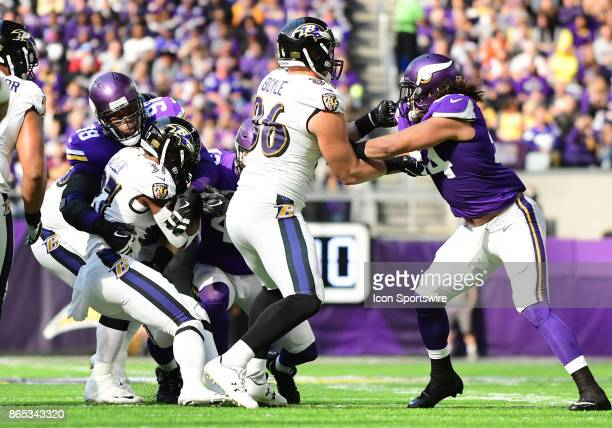 Baltimore Ravens running back Javorius Allen is tackled by Minnesota Vikings defensive tackle Linval Joseph during a NFL game between the Minnesota...