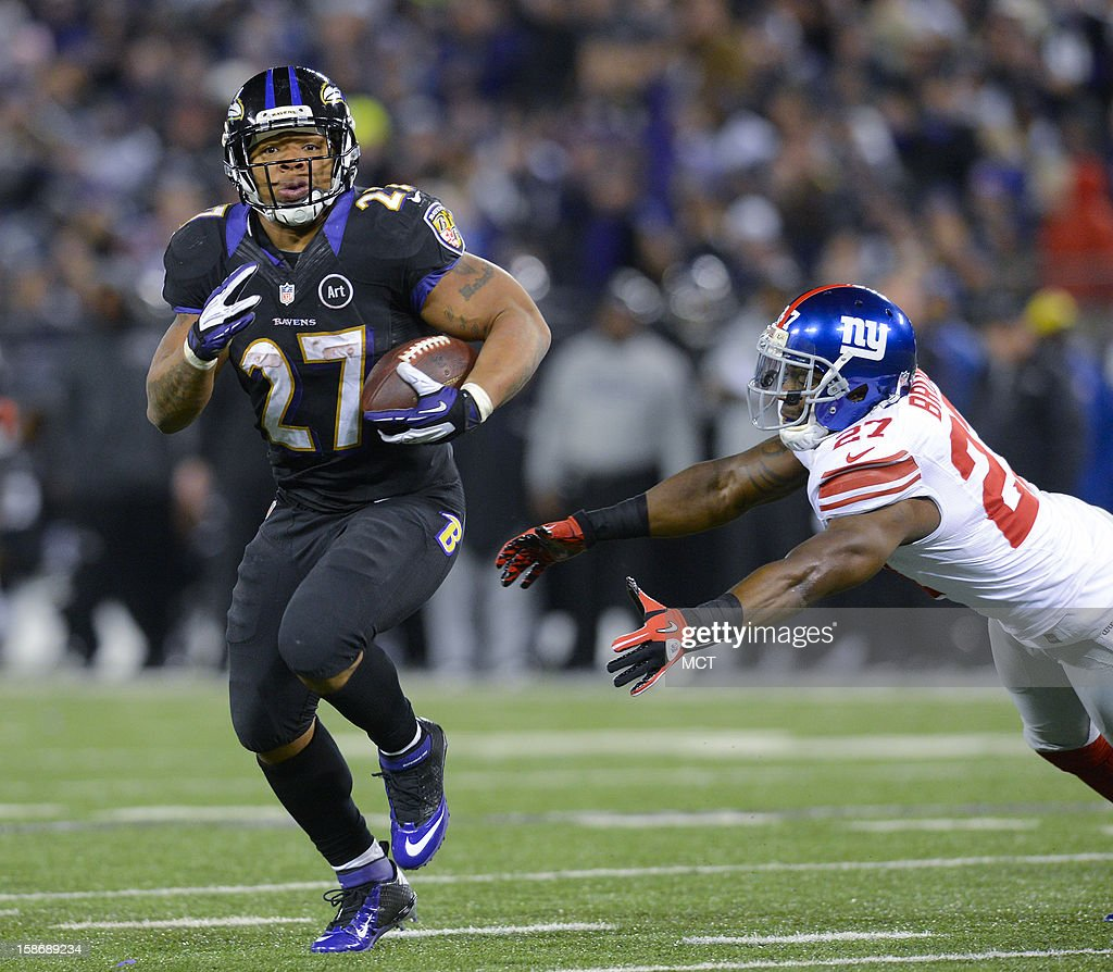 Baltimore Ravens running back Ray Rice eludes the grasp of New York Giants strong safety Stevie Brown, on his way to a touchdown during the first half of their game on Sunday, December 23, 2012, in Baltimore, Maryland.