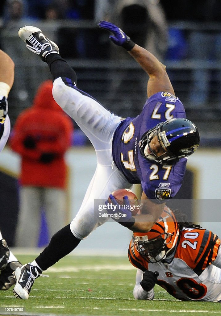 Baltimore Ravens running back <a gi-track='captionPersonalityLinkClicked' href=/galleries/search?phrase=Ray+Rice&family=editorial&specificpeople=3980395 ng-click='$event.stopPropagation()'>Ray Rice</a> (27), left, is tripped by Cincinnati Bengals Reggie Nelson after a 9-yard gain in the fourth quarter. The Ravens defeated the Bengals, 13-7, on Sunday, January 2, 2011, at M&T Bank Stadium in Baltimore, Maryland.