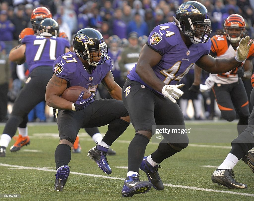 Baltimore Ravens running back Ray Rice makes a cut as teammate Vonta Leach blocks against the Cincinnati Bengals during the fourth quarter of their...