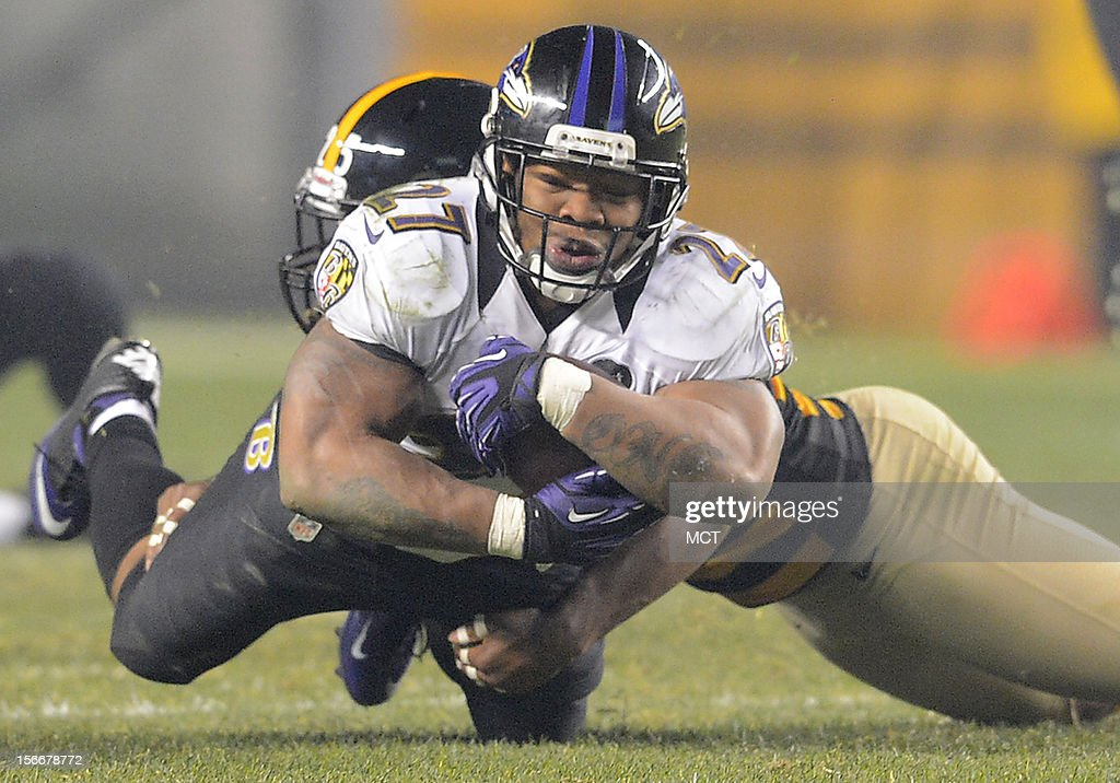 Baltimore Ravens running back Ray Rice picks up a key first down after making a short reception and then being tackled by Pittsburgh Steelers free safety Ryan Clark in the second half of their game on Sunday, November 18, 2012, in Pittsburgh, Pennsylvania.