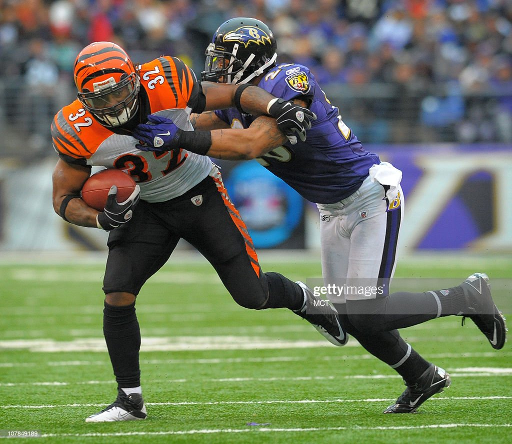 Baltimore Ravens safety Dawan Landry drives Cincinnati Bengals running back Cedric Benson towards the sidelines on a second half run. The Ravens defeat Cincinnati 13-7 on Sunday, January 2, 2011, at M&T Bank Stadium in Baltimore, Maryland.