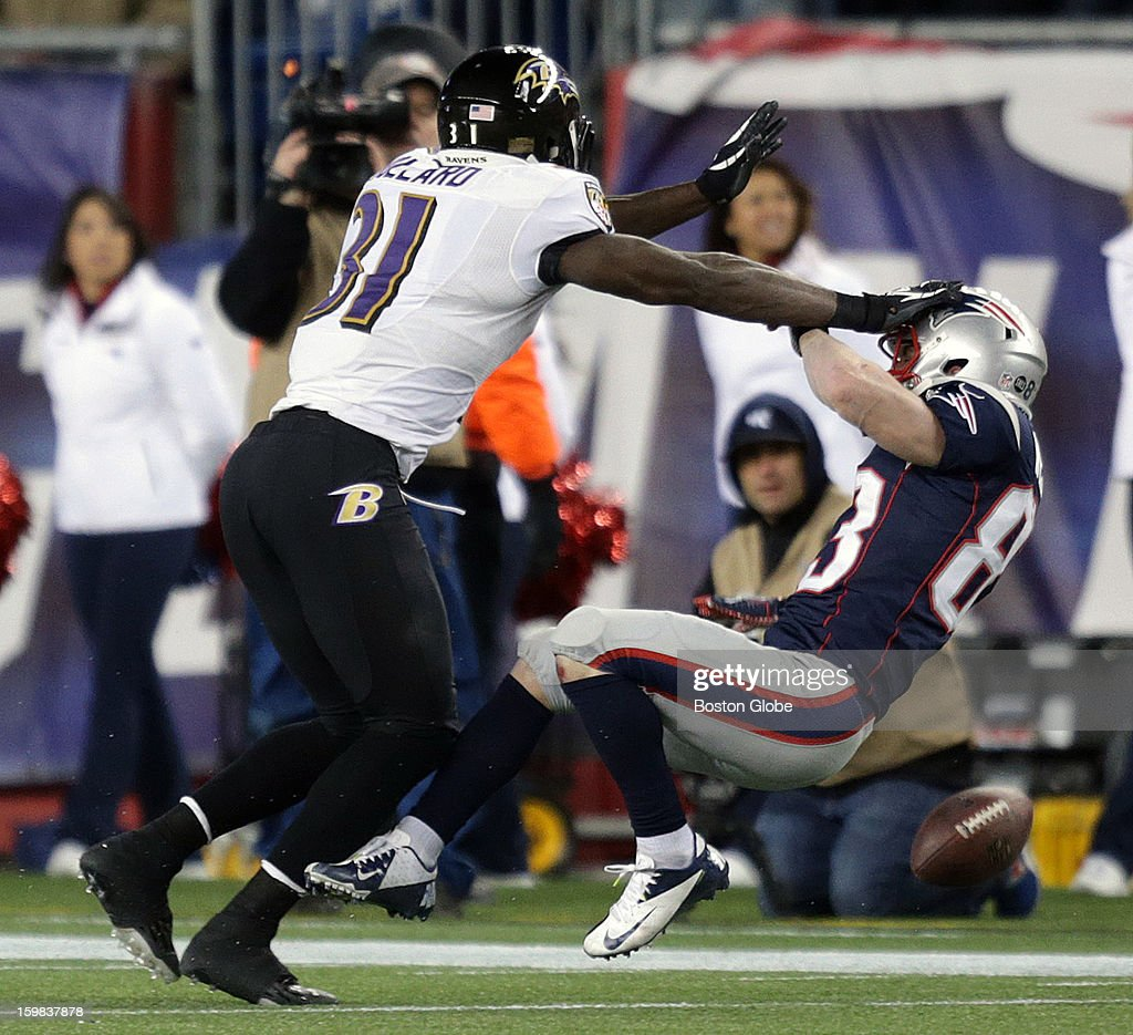 Baltimore Ravens strong safety Bernard Pollard (#31) puts a hit on New England Patriots wide receiver Wes Welker (#83) who can't hold on to the pass late in the fourth quarter as the New England Patriots hosted the Baltimore Ravens in the AFC Championship Game at Gillette Stadium.