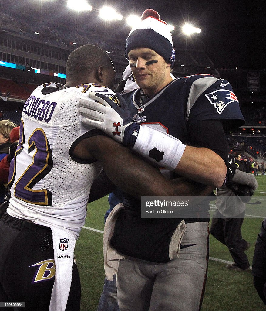Baltimore Ravens strong safety James Ihedigbo (#32) and former Patriot, wishes New England Patriots quarterback Tom Brady (#12) after the game. The New England Patriots hosted the Baltimore Ravens in the AFC Championship Game at Gillette Stadium.