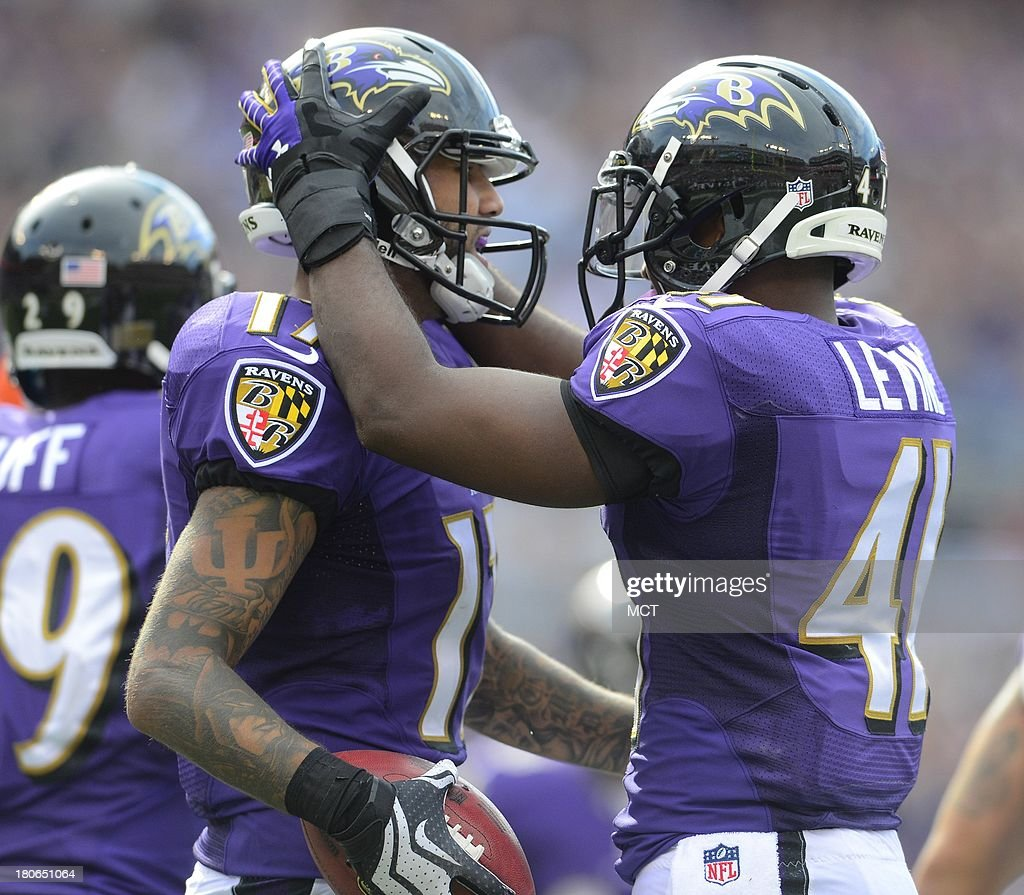 Baltimore Ravens Tandon Doss gets congratulations from teammate Anthony Levine after Doss downs a Sam Koch punt at the one yard line late in the second half of their game on Sunday, September 15, 2013, in Baltimore, Maryland.