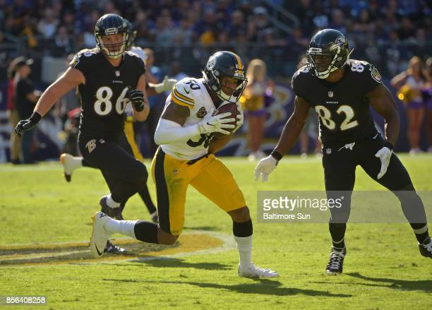 Baltimore Ravens tight end Nick Boyle and intended receiver Benjamin Watson watch Pittsburgh Steelers linebacker Ryan Shazier intercept a pass from...