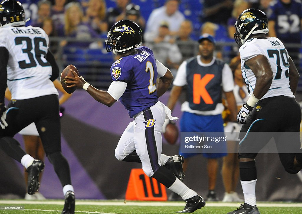 Baltimore Ravens' Tyrod Taylor, middle, runs in for a fourth-quarter touchdown against the Jacksonville Jaguars in NFL preseason action at M&T Stadium in Baltimore, Maryland, on Thursday, August 23, 2012. The Ravens won, 48-17.