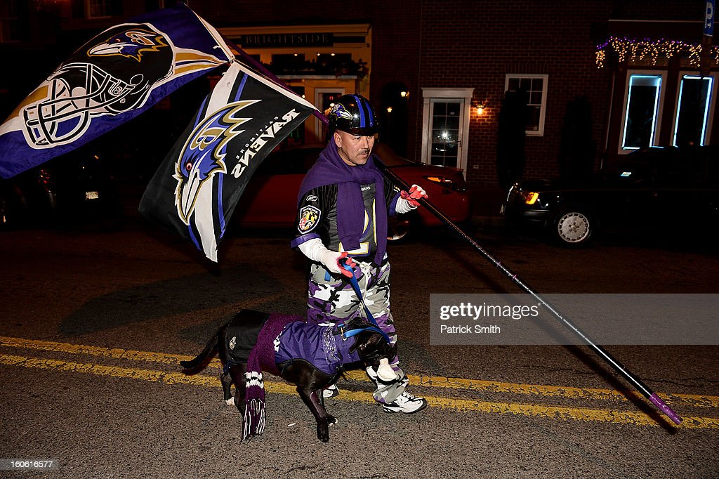 Baltimore Ravens walk down the street as they gather to watch Super Bowl XLVII against the San Francisco 49ers in the neighborhood of Federal Hill on February 3, 2013 in Baltimore, Maryland. The Baltimore Ravens are making their first Super Bowl appearance since they last won in 2000.