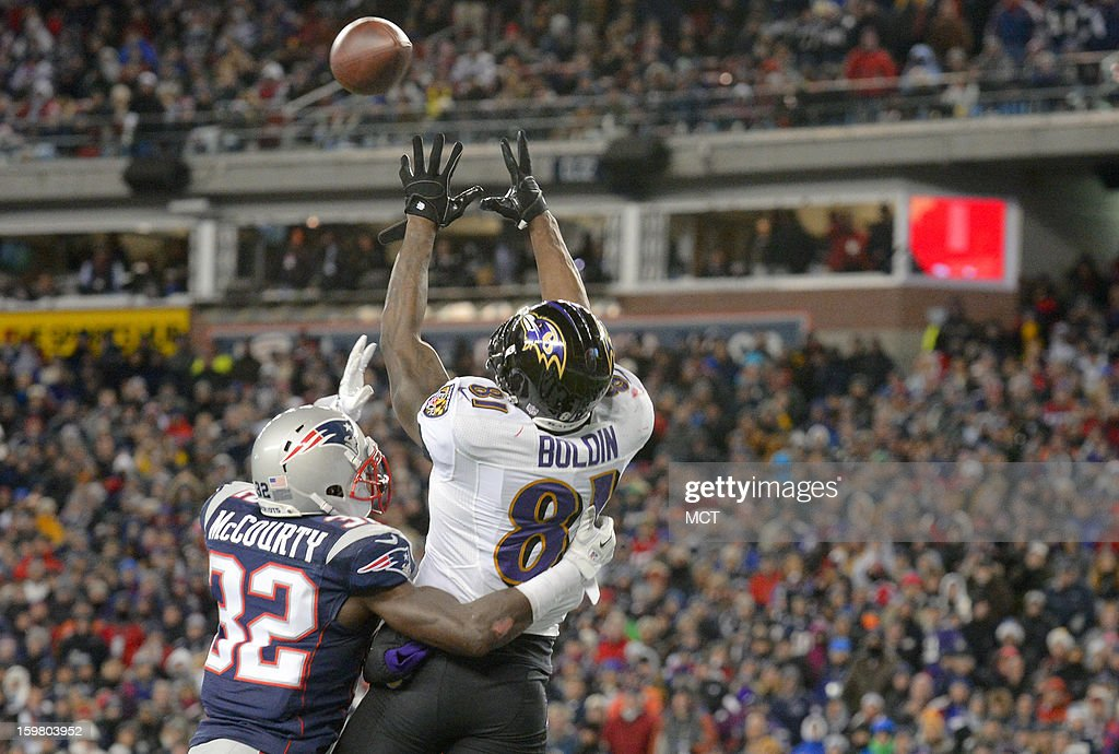 Baltimore Ravens wide receiver Anquan Boldin pulls down the first of his two fourth quarter touchdowns over New England Patriots free safety Devin McCourty during the AFC Championship game at Gillette Stadium in Foxboro, Massachusetts, Sunday night, January 20, 2013.