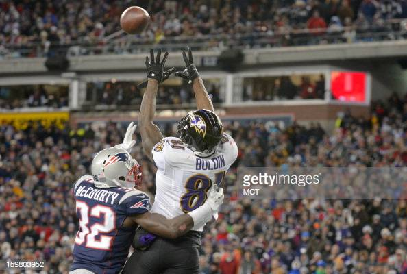 Baltimore Ravens wide receiver Anquan Boldin pulls down the first of his two fourth quarter touchdowns over New England Patriots free safety Devin...