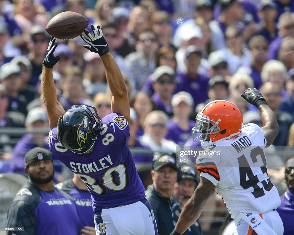 Baltimore Ravens wide receiver Brandon Stokley as a Joe Flacco pass sail over his outstretched hands while being defended by Cleveland Browns strong safety T.J. Ward during the first half of their game on Sunday, September 15, 2013, in Baltimore, Maryland.