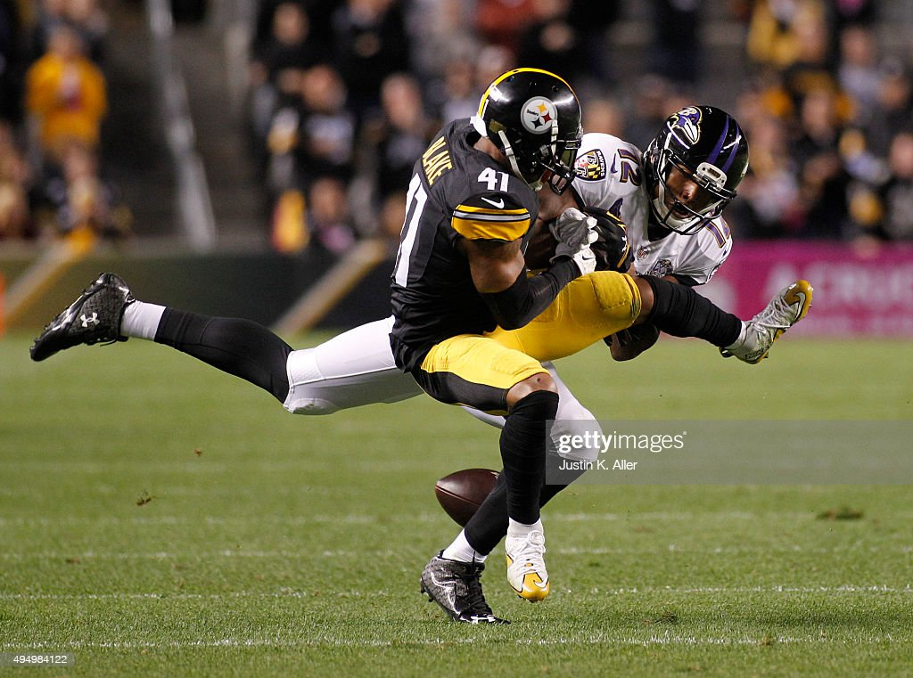Baltimore Ravens wide receiver <a gi-track='captionPersonalityLinkClicked' href=/galleries/search?phrase=Darren+Waller&family=editorial&specificpeople=8583964 ng-click='$event.stopPropagation()'>Darren Waller</a> #12 and Pittsburgh Steelers cornerback <a gi-track='captionPersonalityLinkClicked' href=/galleries/search?phrase=Antwon+Blake&family=editorial&specificpeople=9189947 ng-click='$event.stopPropagation()'>Antwon Blake</a> #41 battle for a ball during the game on October 1, 2015 at Heinz Field in Pittsburgh, Pennsylvania.