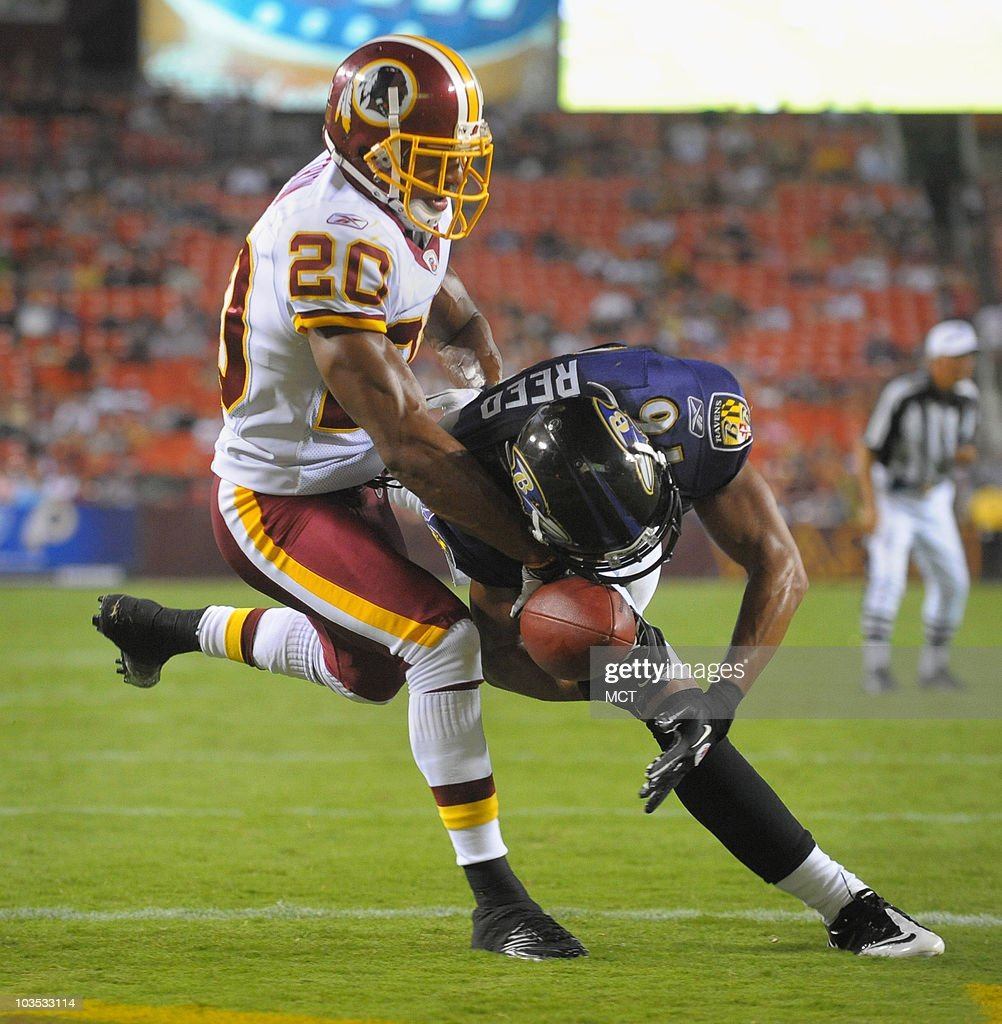 Baltimore Ravens wide receiver David Reed can't hold on to a pass in the end zone while defended by the Washington Redskins' Justin Tryon during...